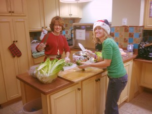 Esther Scott and Michell Musial prepare Ronald McDonald House holiday meals for families of critically ill children.